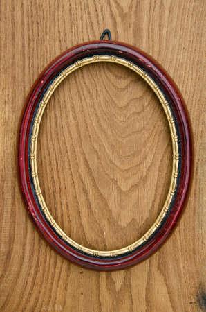 elliptic: vintage empty oval picture art frame on oak plank background