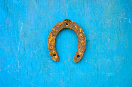 one rusty ancient horseshoe luck symbol  on old wooden wall photo