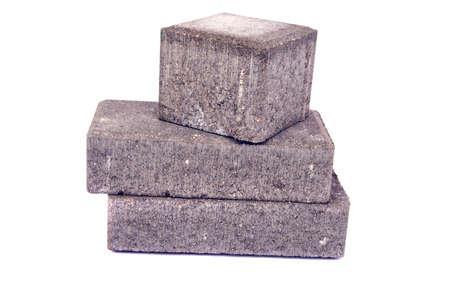 new gray decorative street pavement concrete bricks paving stone isolated on white background