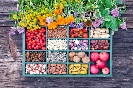 various medical herbs, vegetarian healthy fruits, seeds and dried food ingredient  in wooden box Stockfoto