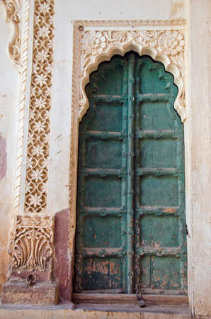 rajput: ancient decorative ornate door in asia, Rajasthan, India Stock Photo