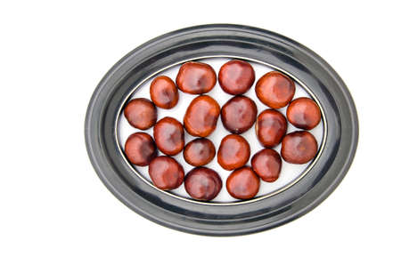 conker: conker fruits seeds chesnuts in  picture oval frame isolated on white Stock Photo