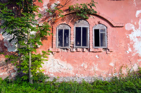 derelict: three historical derelict manor ruins windows and cracked wall Stock Photo