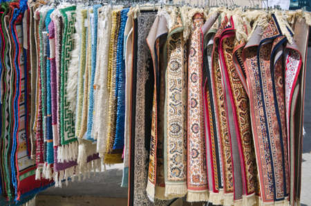 small various decorative ornamental carpets in market, Greece