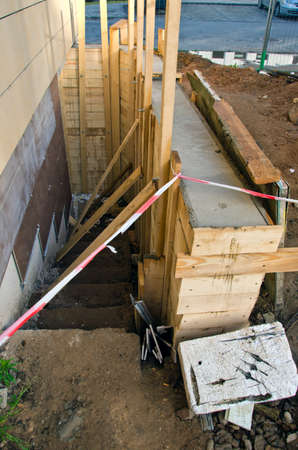 footing: new base foundation near urban house construction for staircase