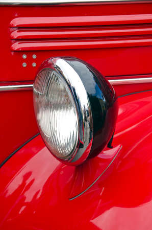 antique fire truck: Headlight of antique firefighters car - old design