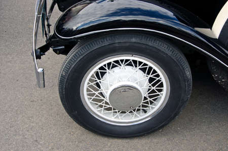 antique car: beautiful wheel of black antique car