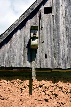 farm building: Bird house on old clay and wood farm building