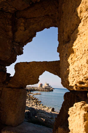 loophole: Fortress seen through the holes in cliffs in Rhodes island, Greece