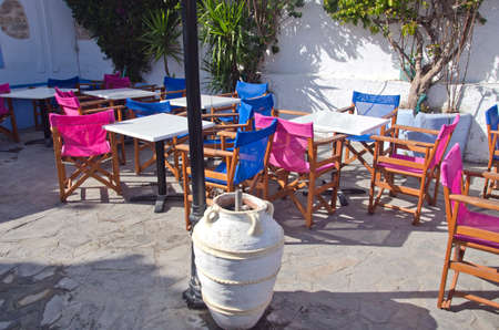 caffe: Caffe in Greece with colorful chairs Stock Photo
