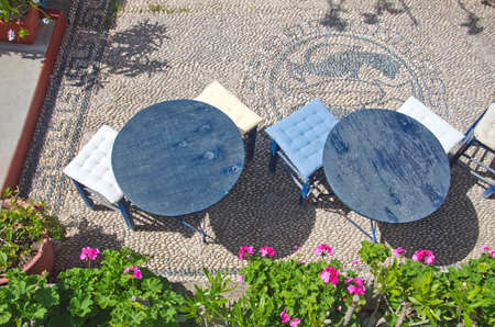 caffe: Caffe from above with stone paved pavement in Greece Stock Photo