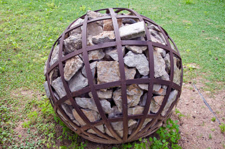 decorative object: Spherical decorative object with stone in park, Rhodes, Greece