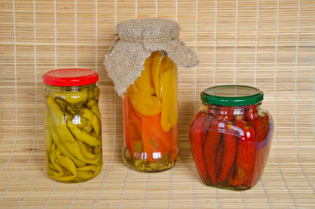 larder: Homemade preserves perpers with cloths in 3 jars