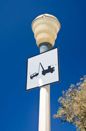 lamp post: Lamp post with a traffic sign in Greece