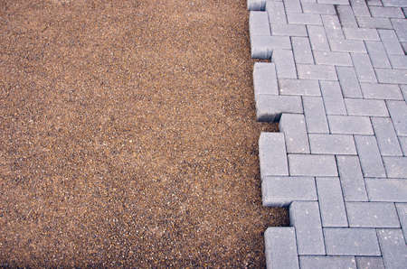 economic activity: An element of paving of sidewalk - work place in street Stock Photo
