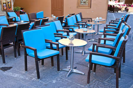 caffe: Rows of blue chairs and metallic tables in a caffe Stock Photo