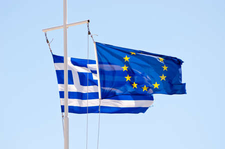 the european economic community: Greek and EU flags on a ship mast. Greece