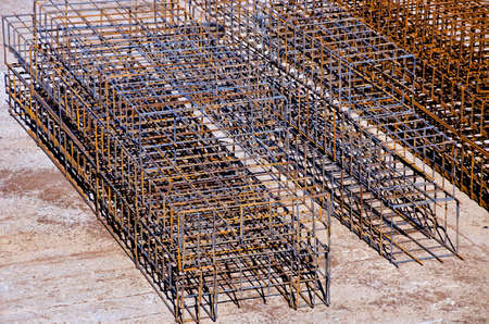 armature: Rusty brown iron armature outdoors in building site Stock Photo