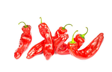 capsaicin: Five twisted fresh red peppers isolated on white  background Stock Photo