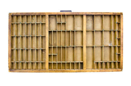 sectioned: Partitioned antique wooden drawer shelf isolated on white Stock Photo