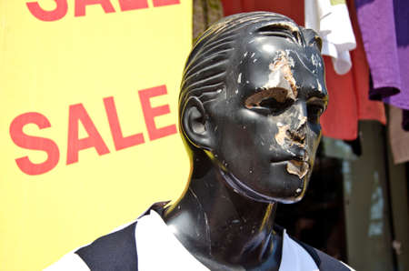 male mannequin: India, face of damaged male mannequin in street