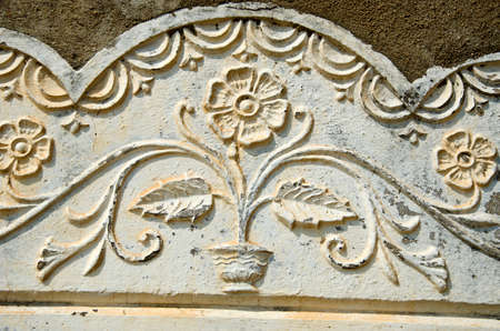 flowery: Old sunlit flowery wall ornament, India
