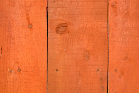 deatil: Orange wooden new farm wall planks background and texture