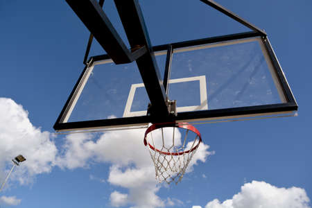 backboard: basketball backboard on blue cloudy summer sky background