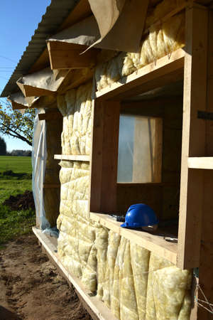 Insulating farm ranch house wall with mineral rock wool