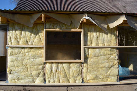 rock wool: insulated wooden house wall with mineral rock wool construction