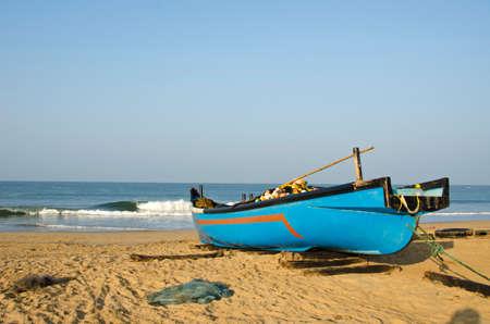 karnataka: Fishing wooden blue boat on sea coast beach in Karnataka, India Stock Photo