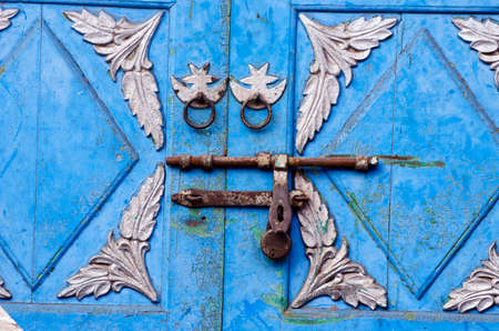 Ornamental vintage asian door fragment background with rusty lock