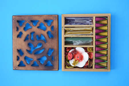 New indian incense wooden box on blue background Stock Photo