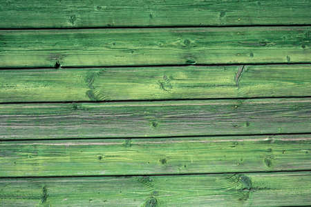 Old green house wall planks background and texture