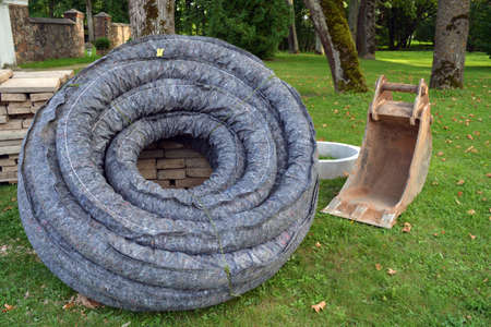 Roll stack drain drainage pipe with protective cover in city park