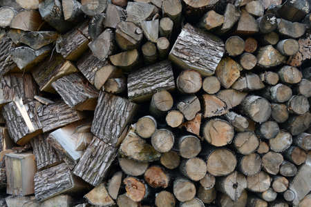 Old firewood outdoor stack background and texture