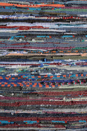 Colorful knitted homemade craft carpet background and texture