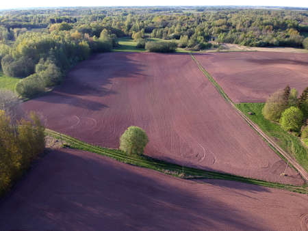Plowed spring time agriculture fields, aerial view