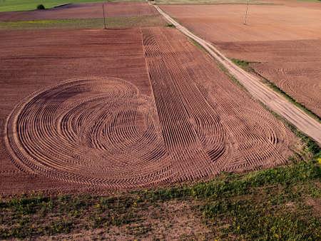 Plowed farm field in summer end, aerial view
