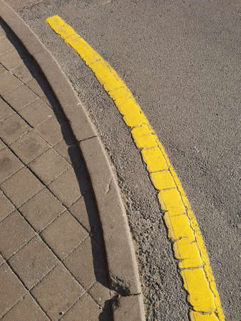 road in the park with a yellow line