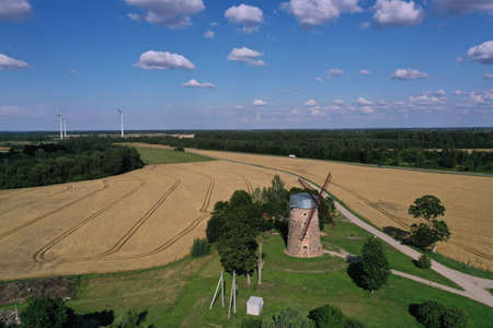 two generation - Old and New Windmills in farmland, Lithuania, aerial