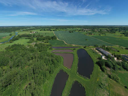 Aerial view city sewage treatment plant ponds Stockfoto