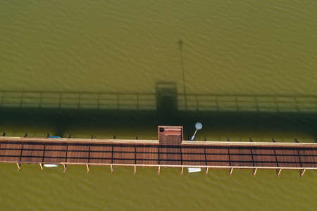 Aerial view of new wooden Bridge over a lake
