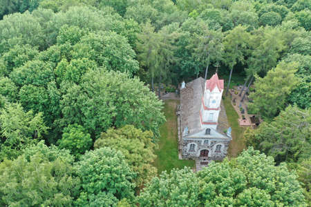 Old historical church in derelict manor park, aerial