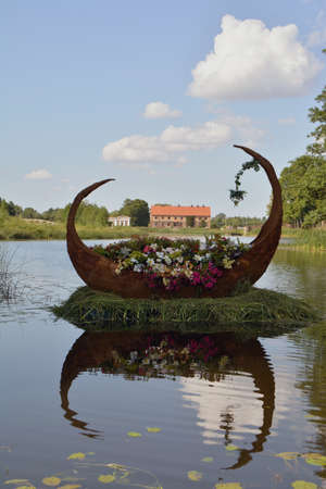 decorative wooden boat full of various flowers in manor park