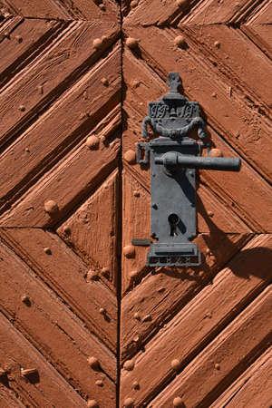 Iron black door handle with decorative fittings Stok Fotoğraf