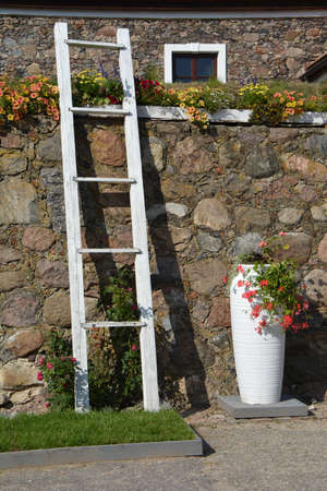 Exterior of old manor decorative wall with ladder