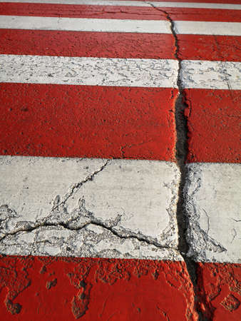 Red and white painted asphalt road cracked background Stok Fotoğraf