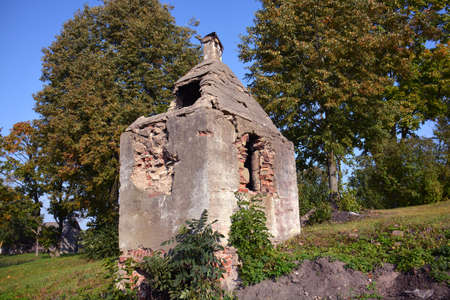 Old historical ruined manor smokehouse in park