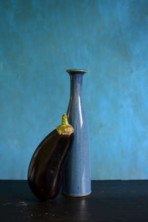 Still life with blue vase and eggplant aubergine
